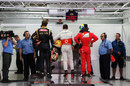 Romain Grosjean, Lewis Hamilton and Felipe Massa wait to be weighed