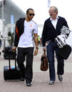 Lewis Hamilton arrives in the paddock with his manager Didier Coton
