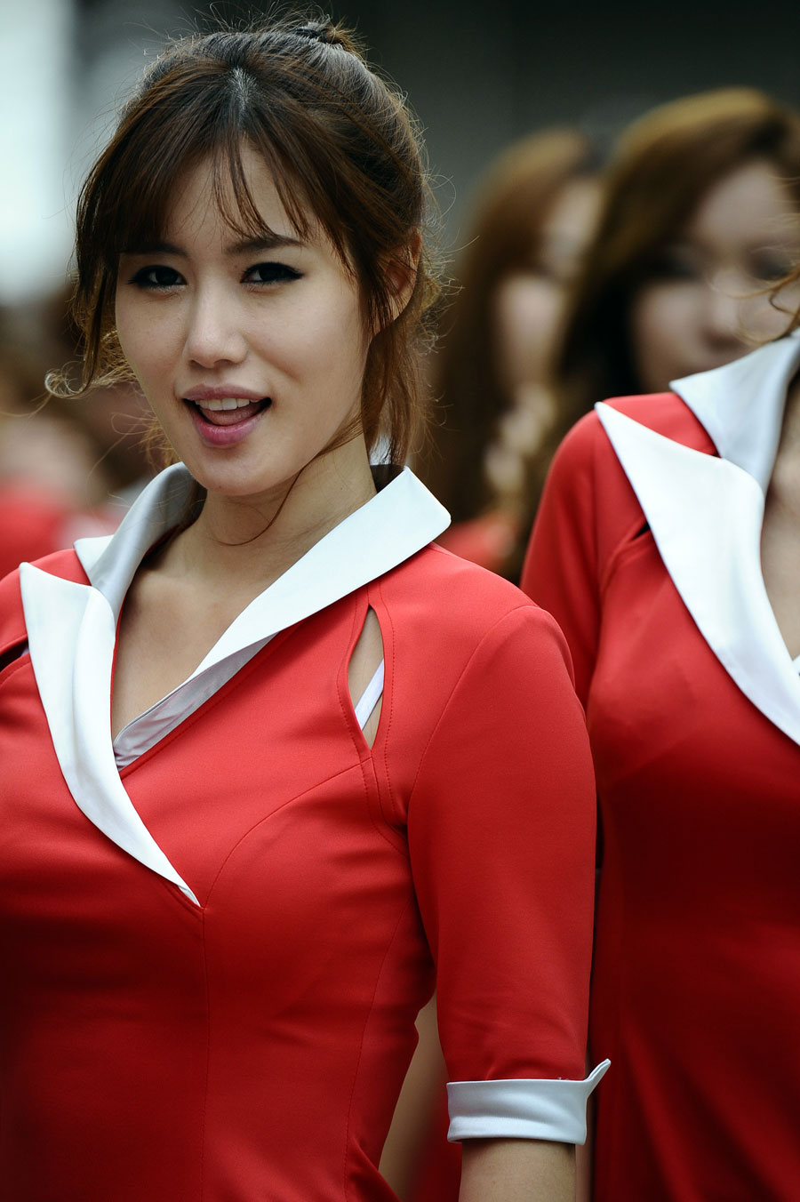 A grid girl ahead of the race