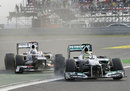 Nico Rosberg and Kamui Kobayashi rejoin the track after running wide