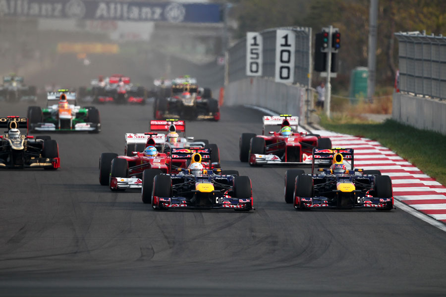 Sebastian Vettel defends from team-mate Mark Webber