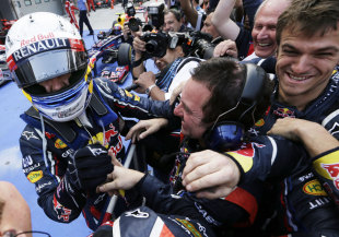Sebastian Vettel celebrates his victory with Red Bull mechanics in parc ferme