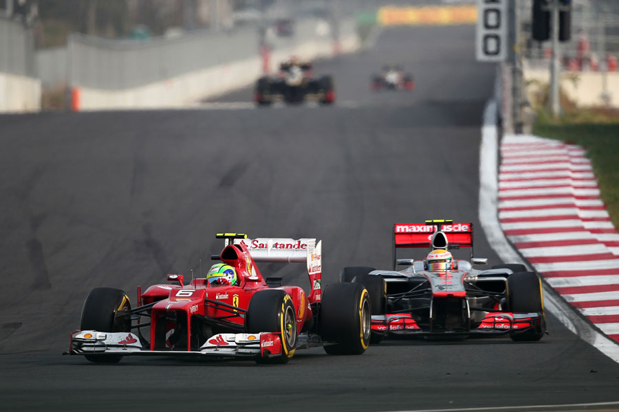 Felipe Massa leads Lewis Hamilton into turn three