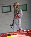 A dejected Lewis Hamilton walks through parc ferme
