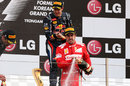 Sebastian Vettel and Fernando Alonso spray champagne on the podium