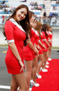 A grid girls prepare for the start of the race
