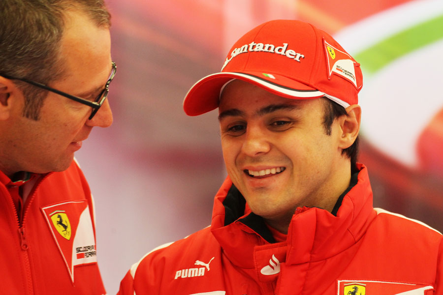 Felipe Massa and Stefano Domenicali joke in the Ferrari paddock