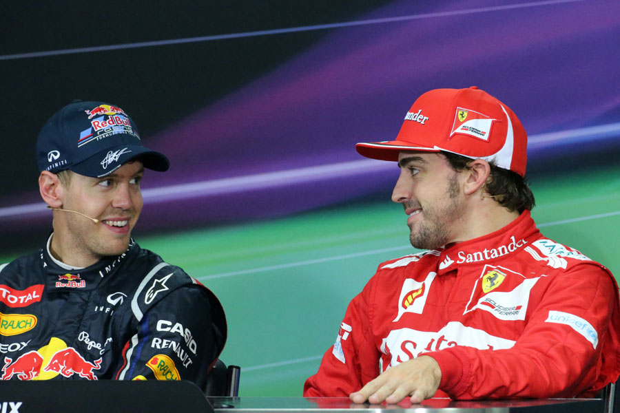 Sebastian Vettel and Fernando Alonso chat in the post race press conference