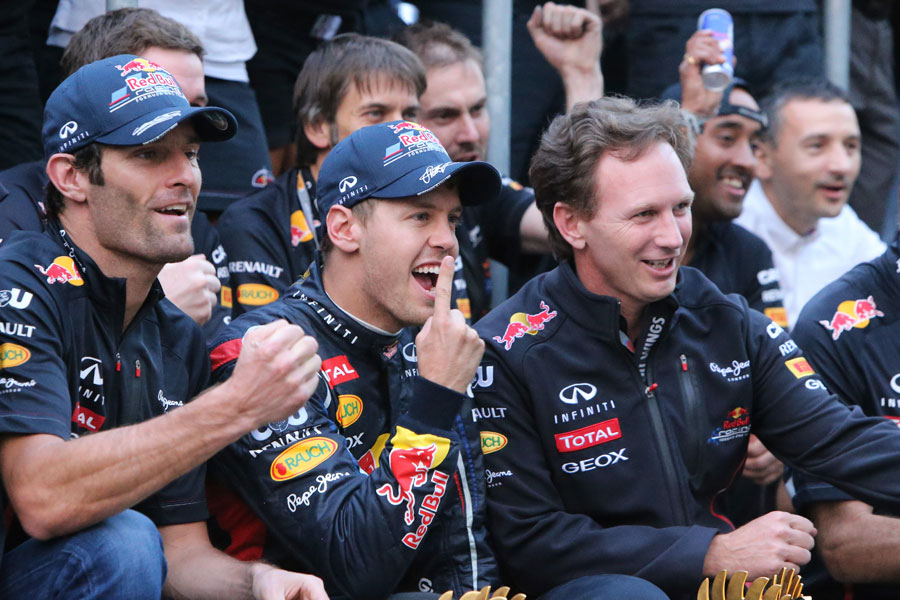 Mark Webber, Sebastian Vettel and Christian Horner celebrate Red Bull's one-two