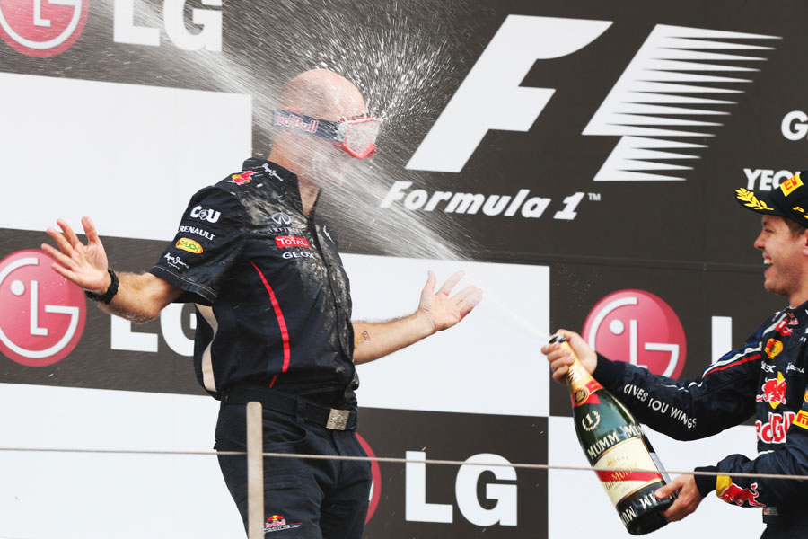 Adrian Newey comes prepared for the podium celebrations