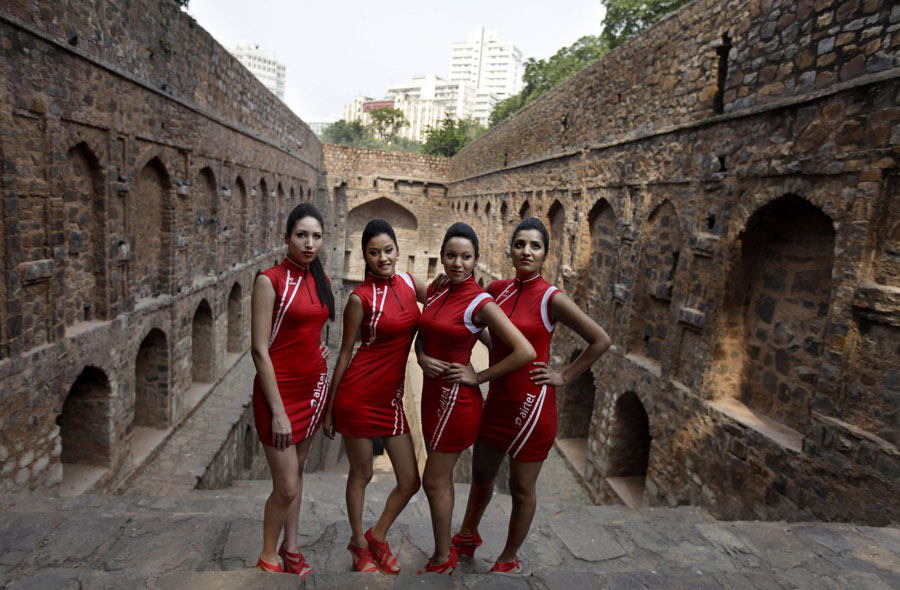 Grid girls pose during a photoshoot to promote the Indian Grand Prix