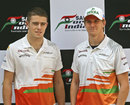 Paul di Resta and Nico Hulkenberg pose before a press conference