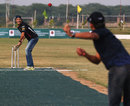 Mark Webber faces up to the bowling of Indian cricketer Gautam Gambhir