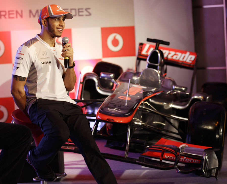 Lewis Hamilton chats to the press at a media event