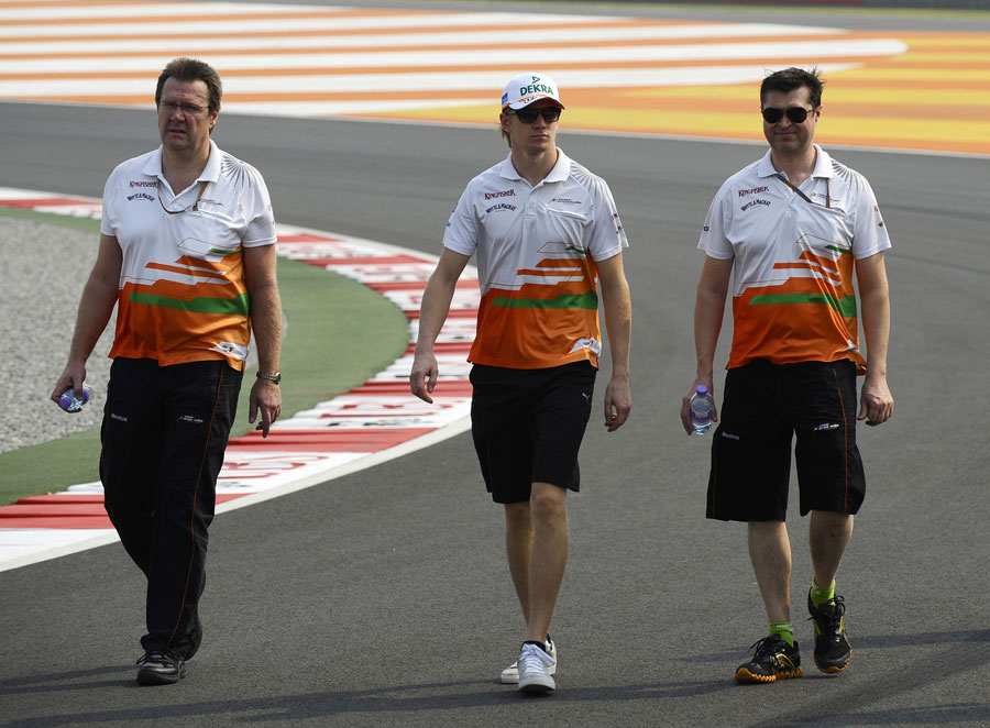Nico Hulkenberg walks the track with his engineers