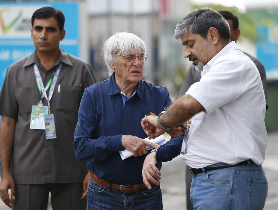 Bernie Ecclestone and Vicky Chandhok in the paddock on Thursday