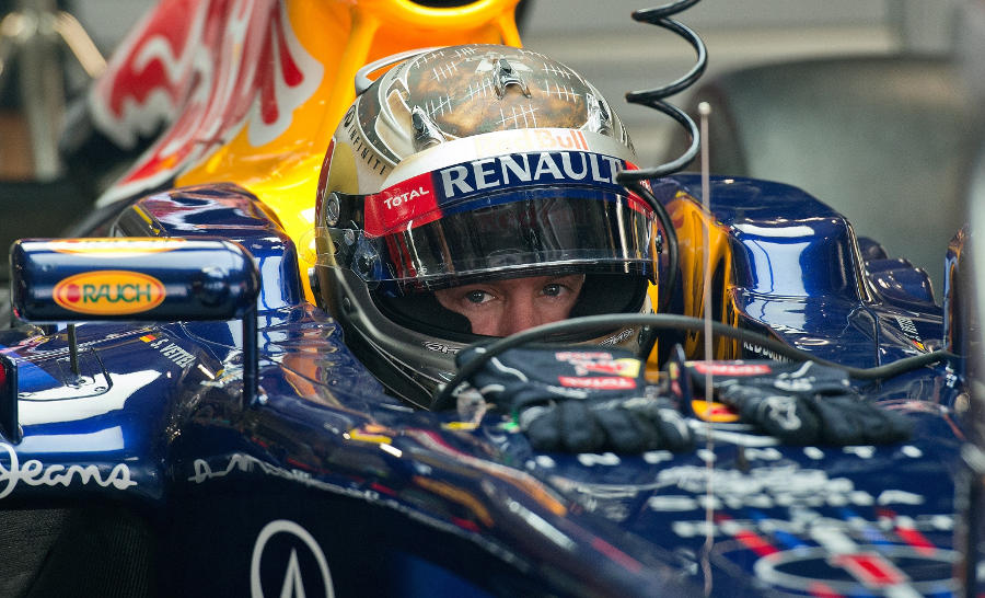 Sebastian Vettel waits in the pits during FP1