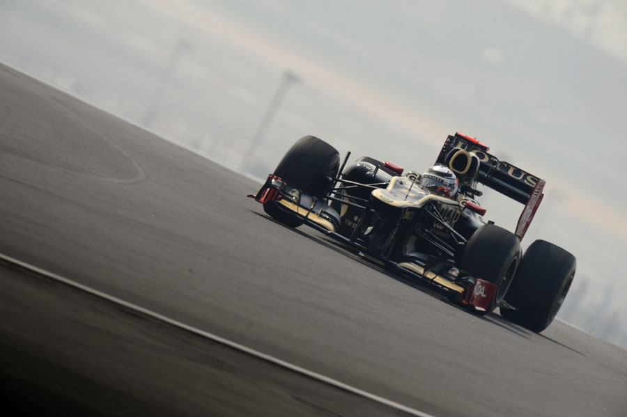 Kimi Raikkonen picks his line through turn three