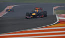 Sebastian Vettel leads Mark Webber on track