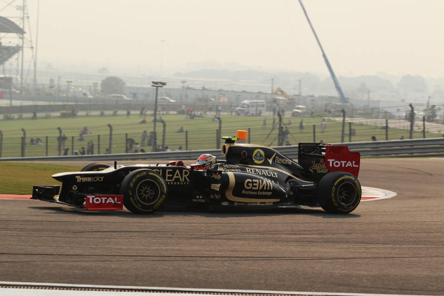 Romain Grosjean crests the hill at turn three