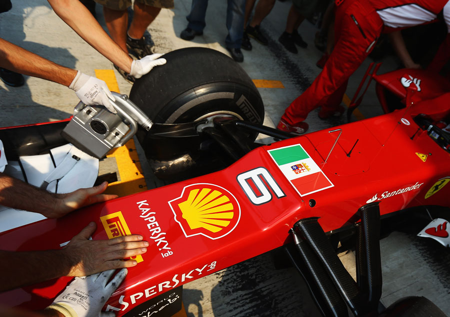 The Italian naval flag on the front of Felipe Massa's car in final practice