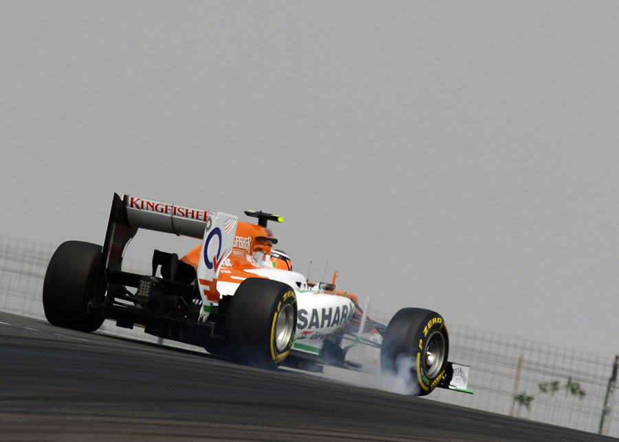 Nico Hulkenberg locks a wheel in his Force India