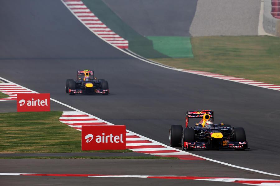 Sebastian Vettel leads Mark Webber on track