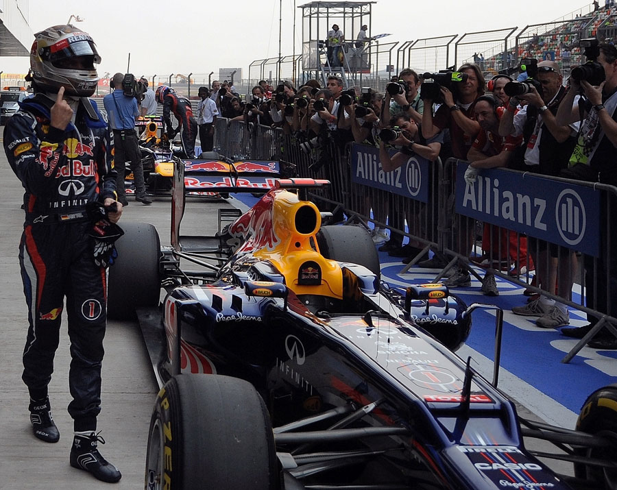 Sebastian Vettel celebrates pole position in India