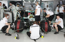 Mercedes mechanics work on Nico Rosberg's car