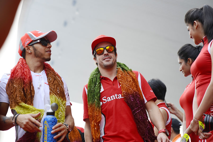 Lewis Hamilton and Fernando Alonso on the way to the drivers' parade