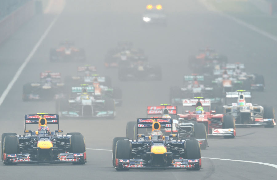 Sebastian Vettel holds off Mark Webber in to turn one