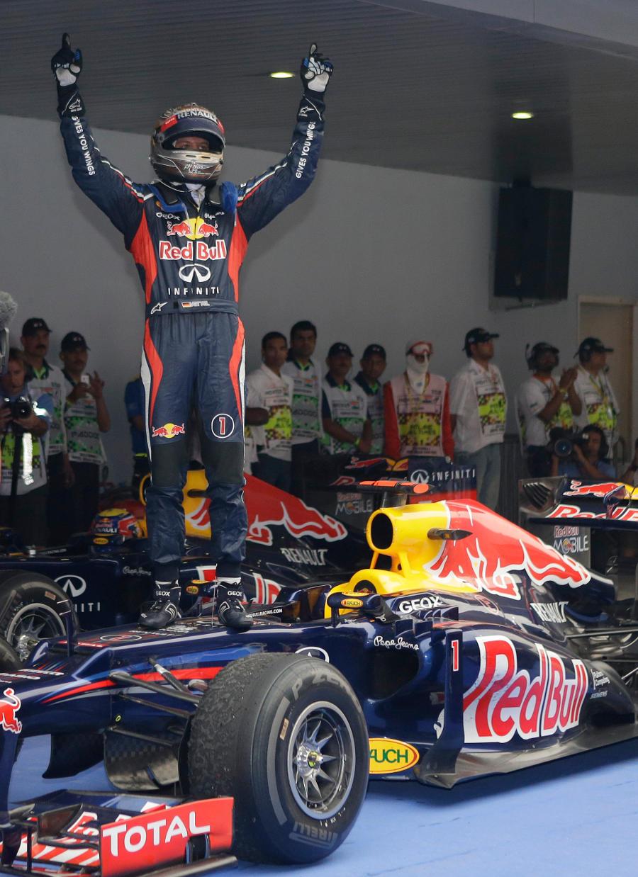 Sebastian Vettel celebrates his victory in parc ferme