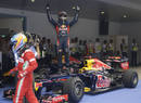 Sebastian Vettel celebrates his victory in parc ferme as Fernando Alonso walks by