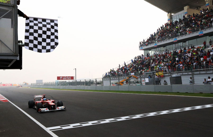 Fernando Alonso crosses the line for second