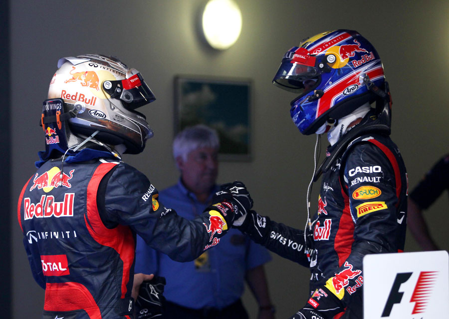 Mark Webber congratulates Sebastian Vettel on victory