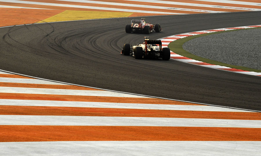 Felipe Massa leads Kimi Raikkonen during the race
