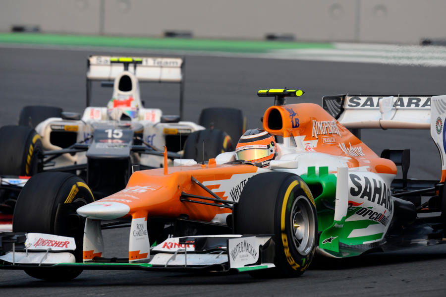 Nico Hulkenberg gets past Sergio Perez in to turn four