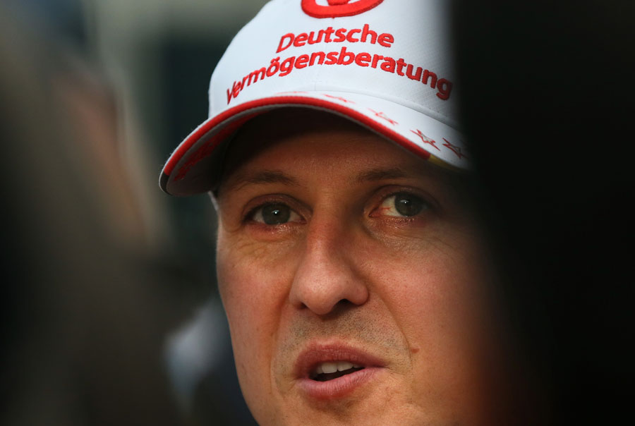 Michael Schumacher talks to the press