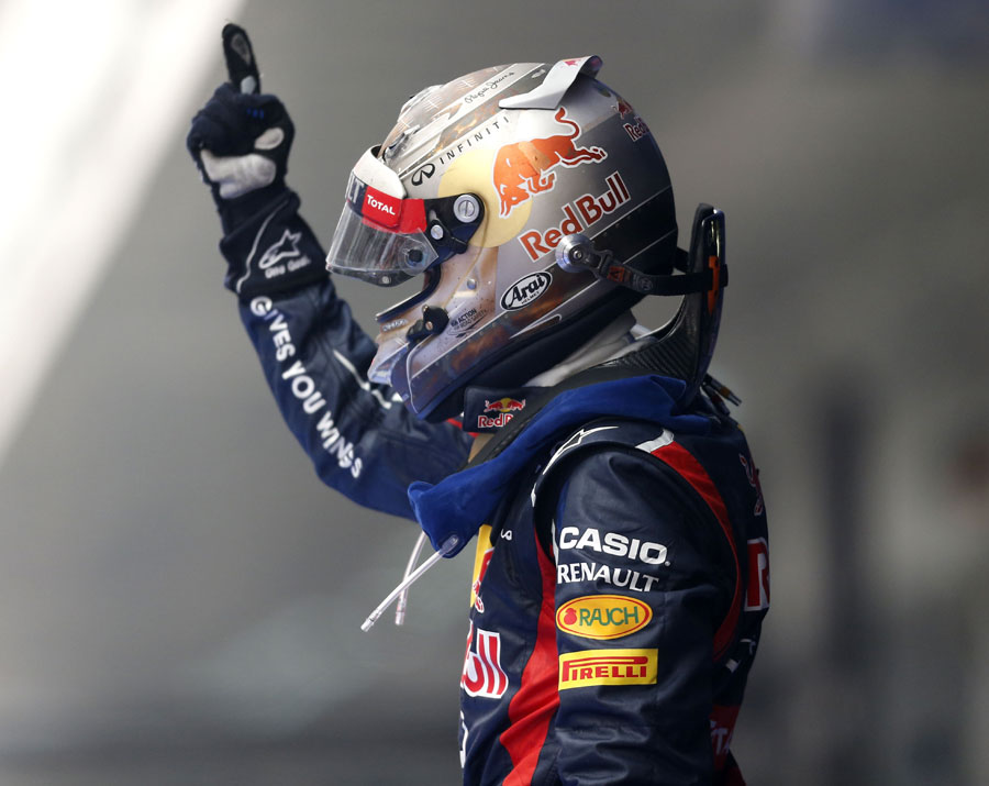 Sebastian Vettel celebrates his victory in parc ferme
