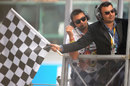 London Olympics bronze medallist Gagan Narang waves the chequered flag