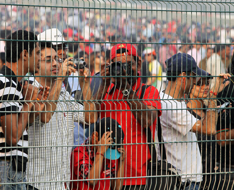 Fans press up to the fence to get a better view