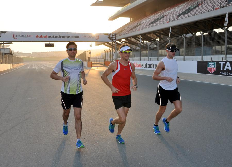 Jenson Button runs Dubai Autodrome with his trainer Mike Collier and Richard Williams