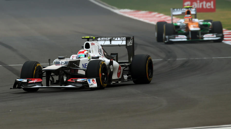 Sergio Perez leads Nico Hulkenberg in to turn one