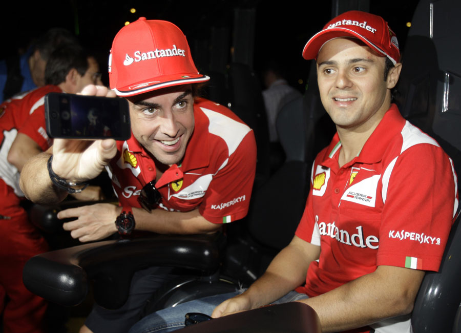 Fernando Alonso and Felipe Massa lark about at the Ferrari World entertainment park in Abu Dhabi