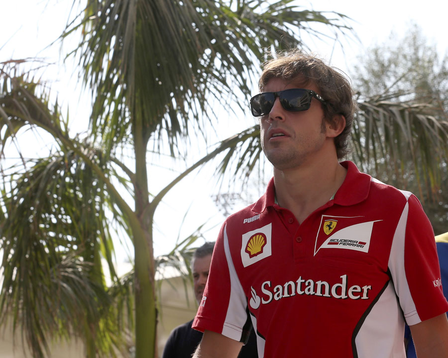 Fernando Alonso walks through the paddock on Thursday