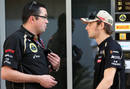 Romain Grosjean and Eric Boullier chat in the pit lane