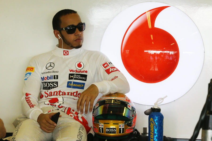 Lewis Hamilton waits in the McLaren garage during first practice