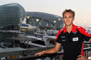 Max Chilton poses in front of the Yas Hotel