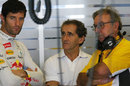 Mark Webber talks to four-time champion Alain Prost and Renault Sport boss Jean-Francois Caubet between practice runs