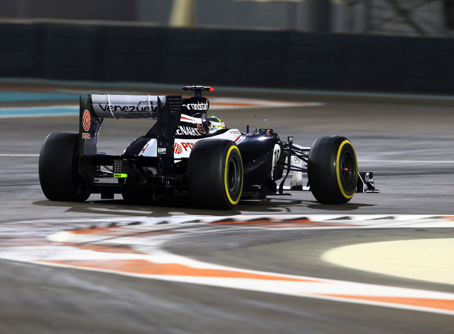 Pastor Maldonado picks his way through one of Abu Dhabi's anonymous chicanes